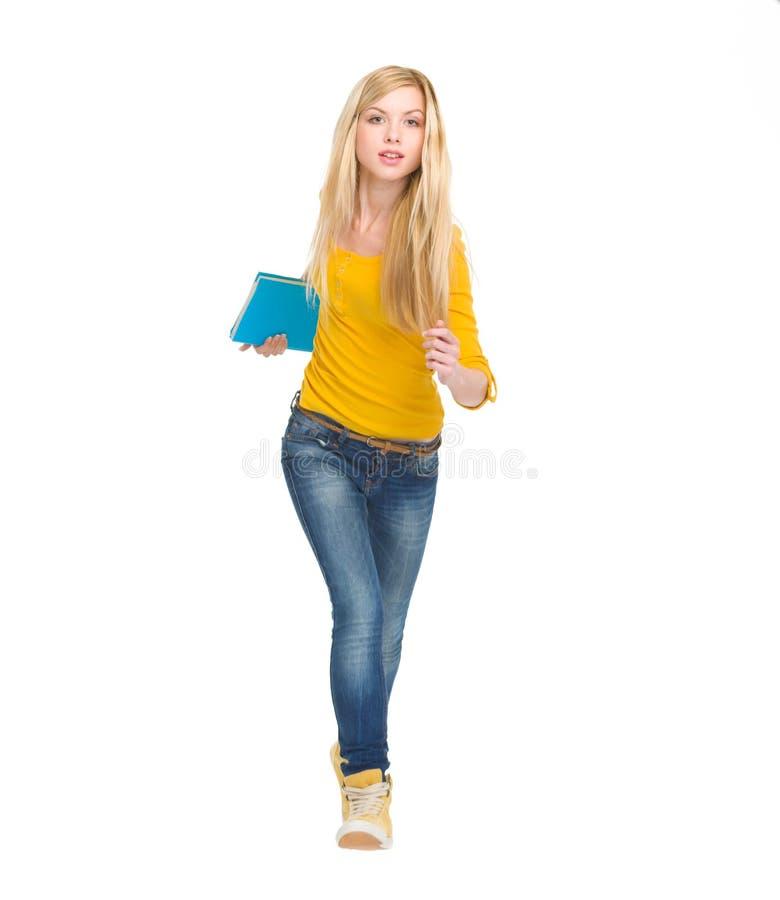 Studentenmädchen, das gerade läuft stockfotos