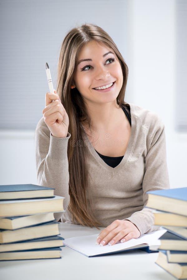Studentenmeisje met idee stock foto's