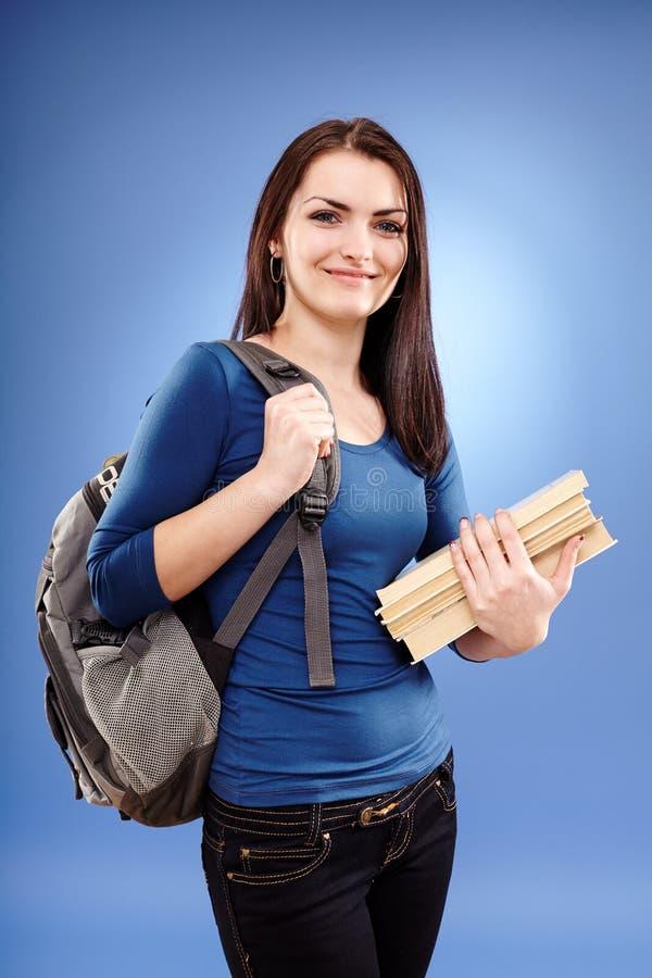 Studentenmeisje met rugzak en boeken royalty-vrije stock afbeeldingen