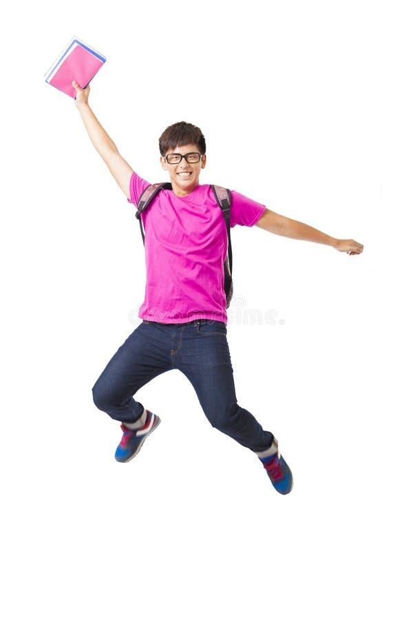 Studentenspringen des jungen Mannes stockfotografie