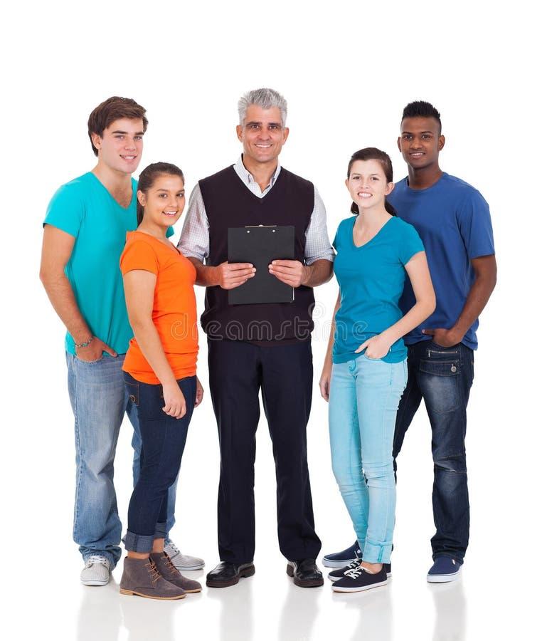 Studenter för skolalärare royaltyfri bild