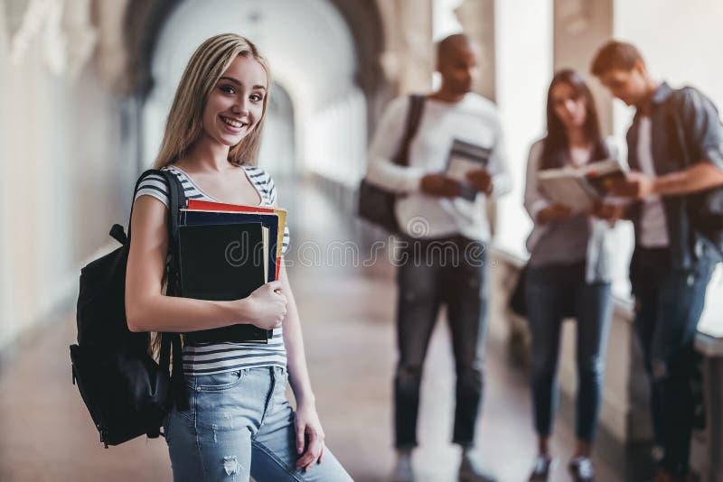 Studenter i universitet royaltyfria bilder