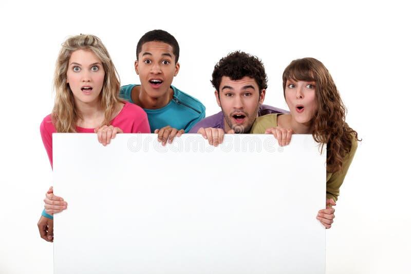 Studenter som rymmer copyspace royaltyfria foton