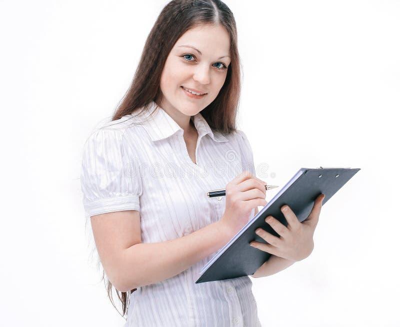 Studentessa con il computer portatile Isolato su bianco immagine stock libera da diritti
