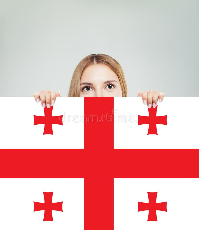 Studentessa felice con i precedenti della bandiera di Georgia immagine stock libera da diritti