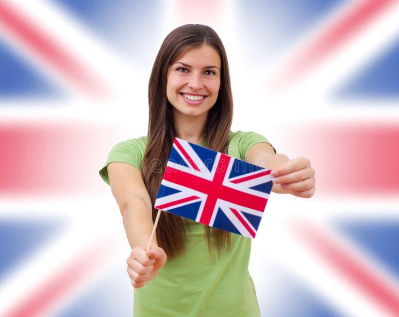 StudentFemale With British flagga arkivbild