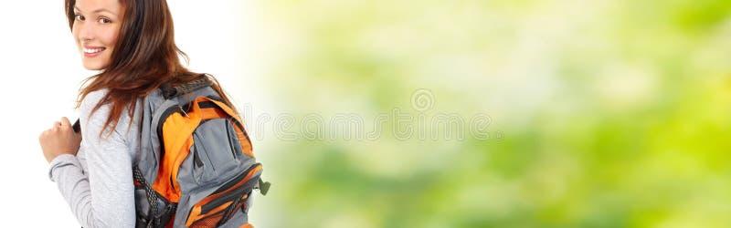 Studentflicka med ryggsäcken arkivfoto