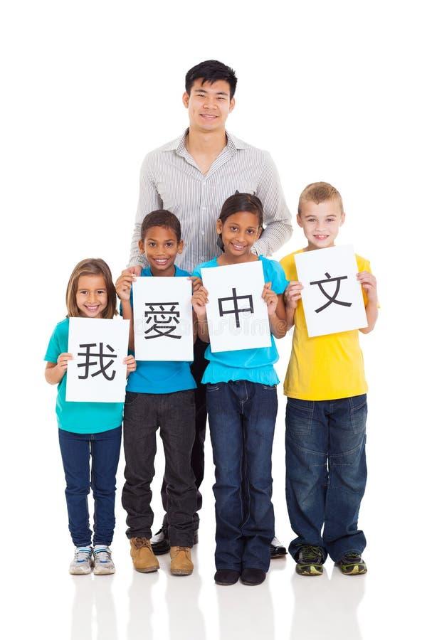 Studenti cinesi dell'insegnante fotografia stock libera da diritti