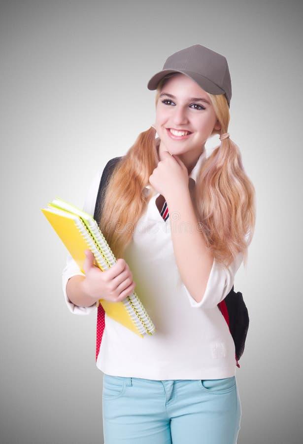 Studentin mit Büchern auf Weiß stockbilder