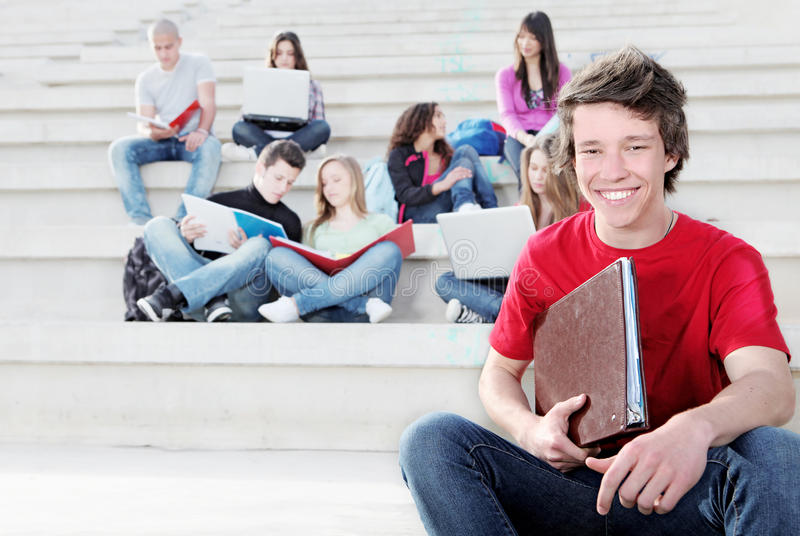 Students. Group of teenagers students at campus at college school or university stock photography