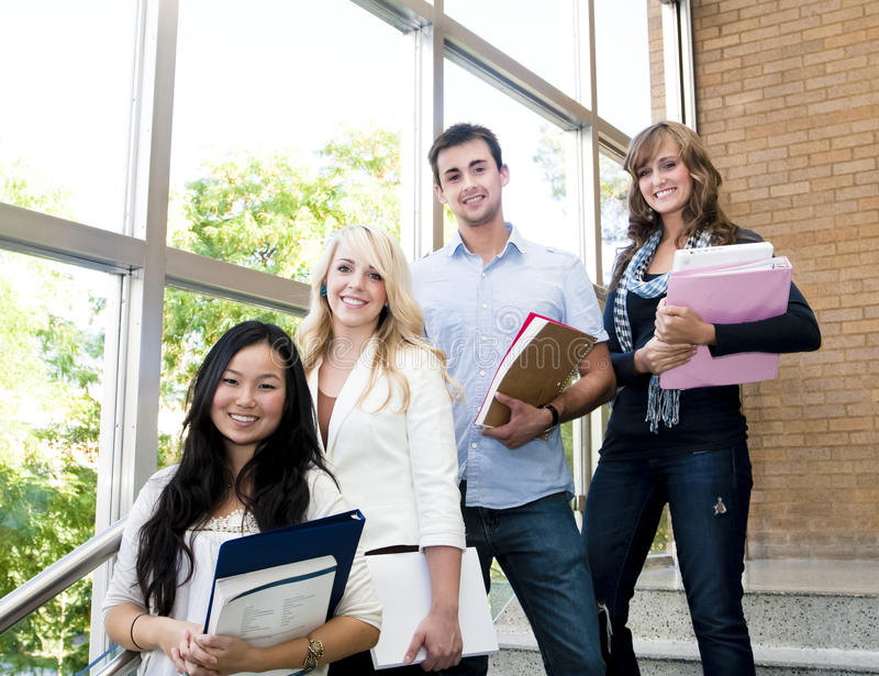 Students. Young group of male and female students inside an academic building royalty free stock image