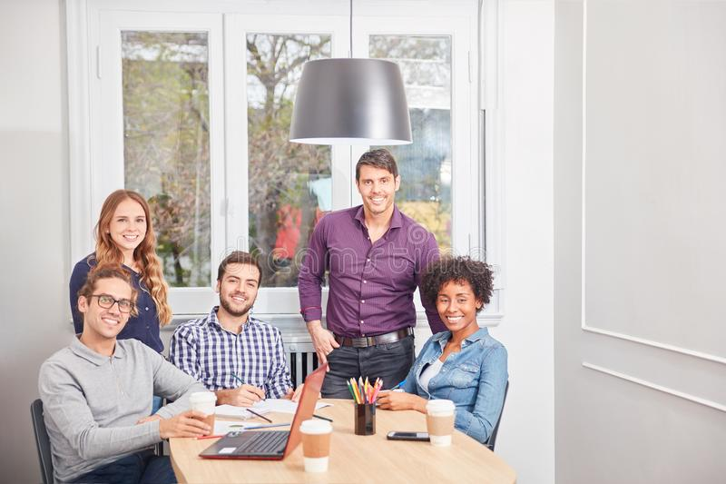 Students as multicultural business team royalty free stock photos