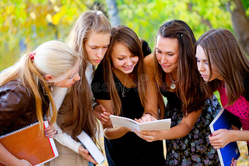 Students with books. On nature background royalty free stock photos