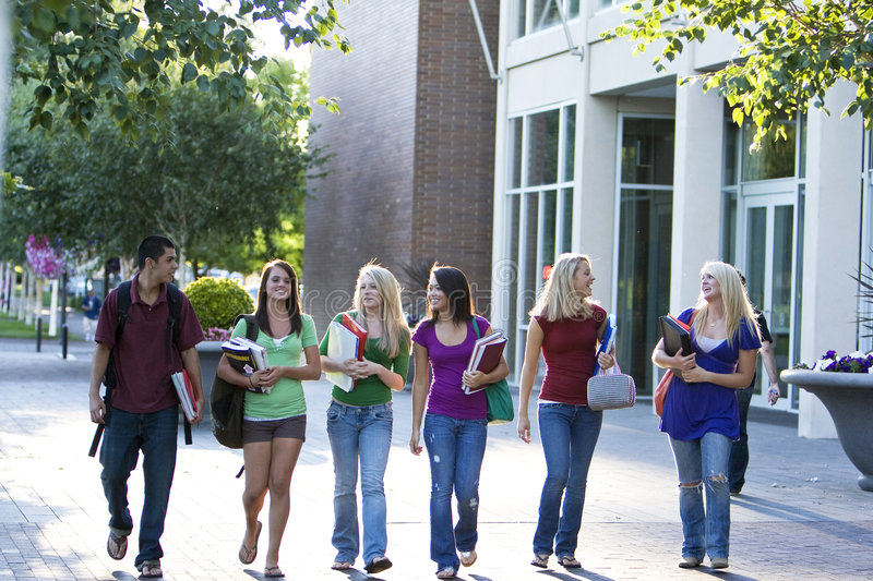 Students Carrying Books stock image