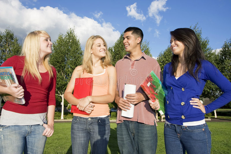 Students Carrying Books stock images