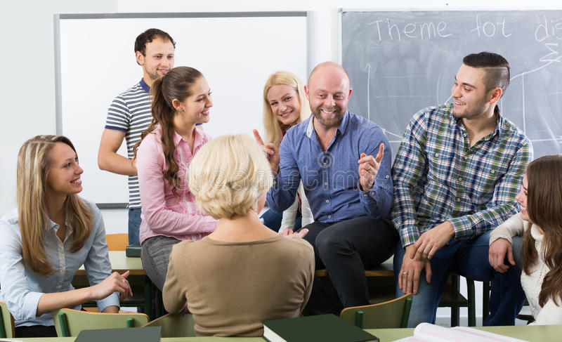Students chatting at training session for employees during break royalty free stock photos