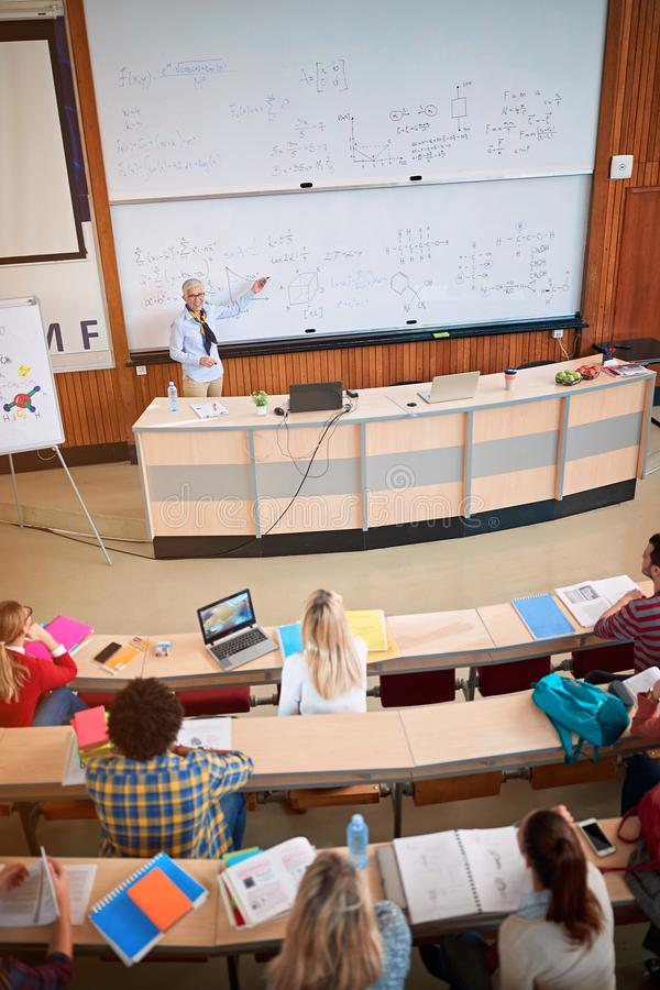Students in class - professor in training class with students royalty free stock photo