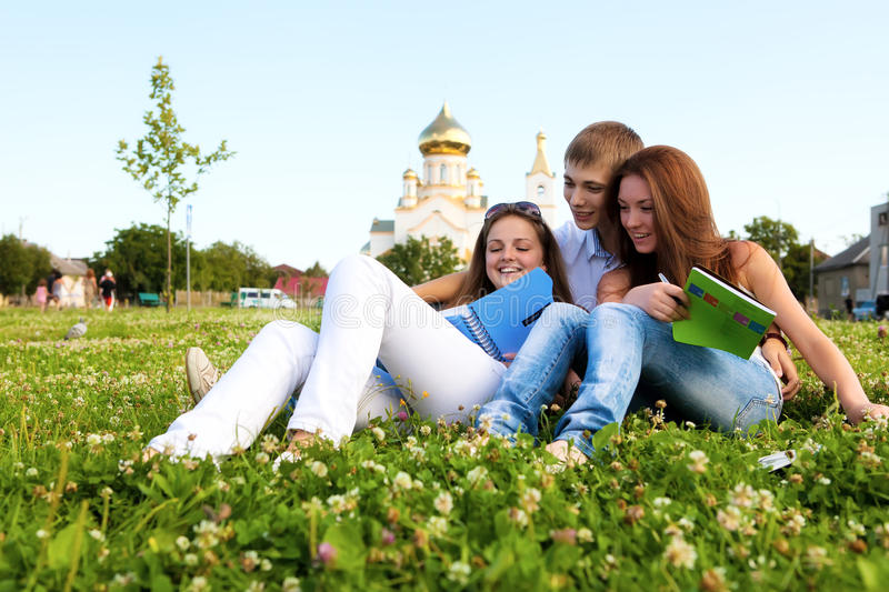 Students in a clearing in  background of church
