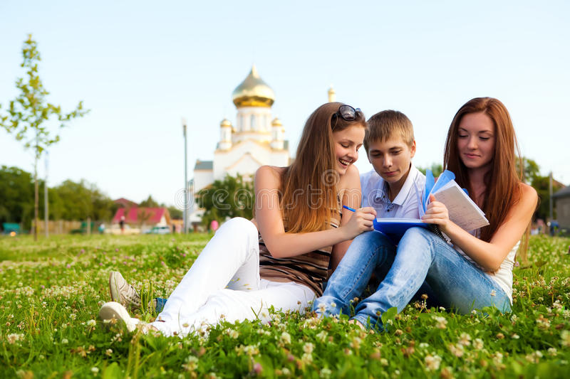Download Students In A Clearing In  Background Of Church Stock Photo - Image of connections, horizontal: 21065802