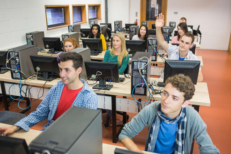 Students in the college computer room. Group of concentrated students using computers in the college computer room stock photography