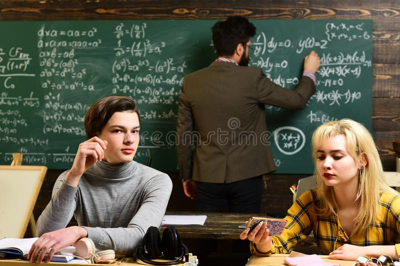 Students communicating during recess between lectures in an auditorium. Personal relationships are foundational to. Student success. Concept education - back to stock image