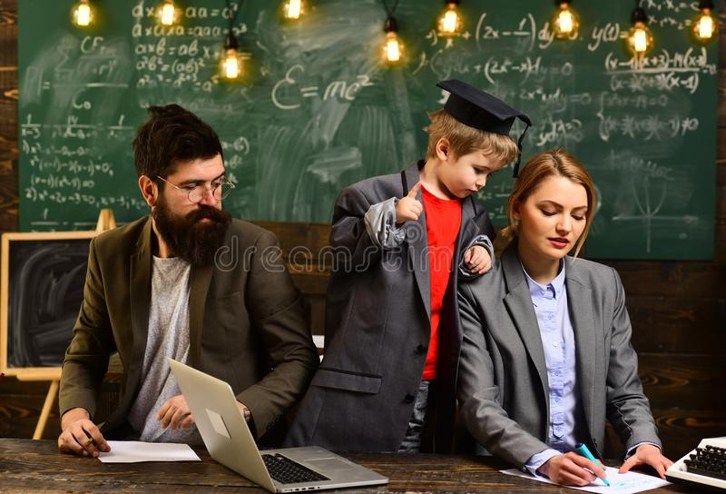 Students are communicating on regular basis with the tutor. University male speaker conducts business training. Awesome. Teachers know about things that make royalty free stock photos