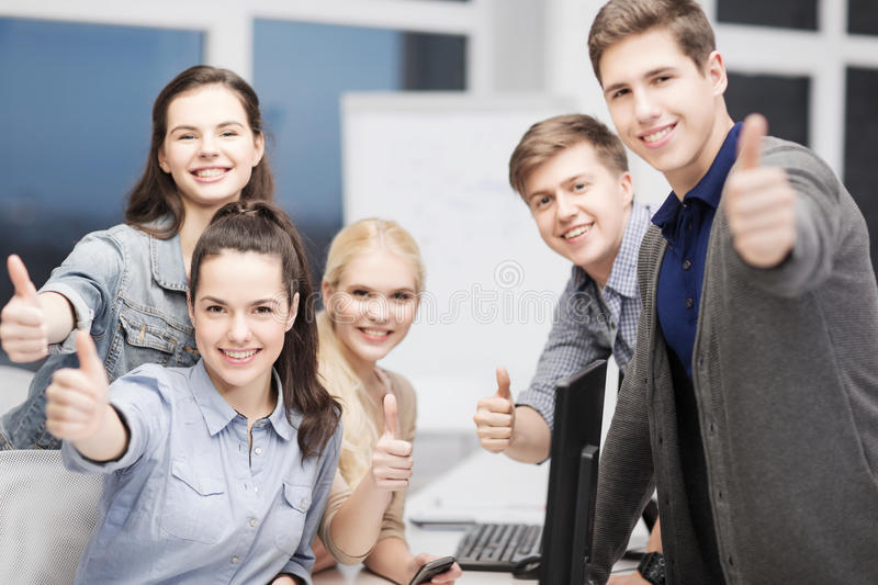 Students with computer monitor and smartphones. Education, school and people concept - students with computer monitor and smartphones royalty free stock photo