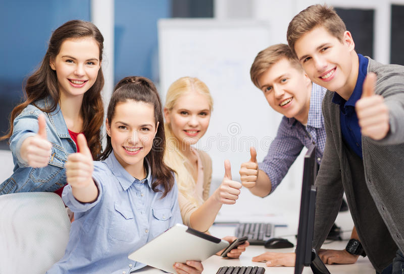 Students with computer monitor and tablet pc. Education, techology and internet concept - group of smiling students with computer monitor and tablet pc stock photos