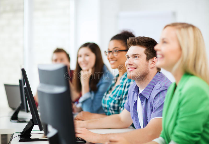 Students With Computers Studying At School Royalty Free Stock Image