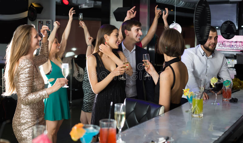 Students dancing in the bar royalty free stock photography