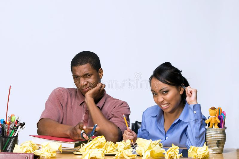 Students at Desk with Crumpled Paper -Horizontal royalty free stock photo