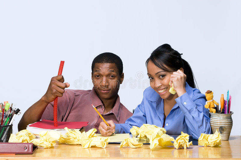 Students at Desk with Crumpled Paper - Horizontal stock photos