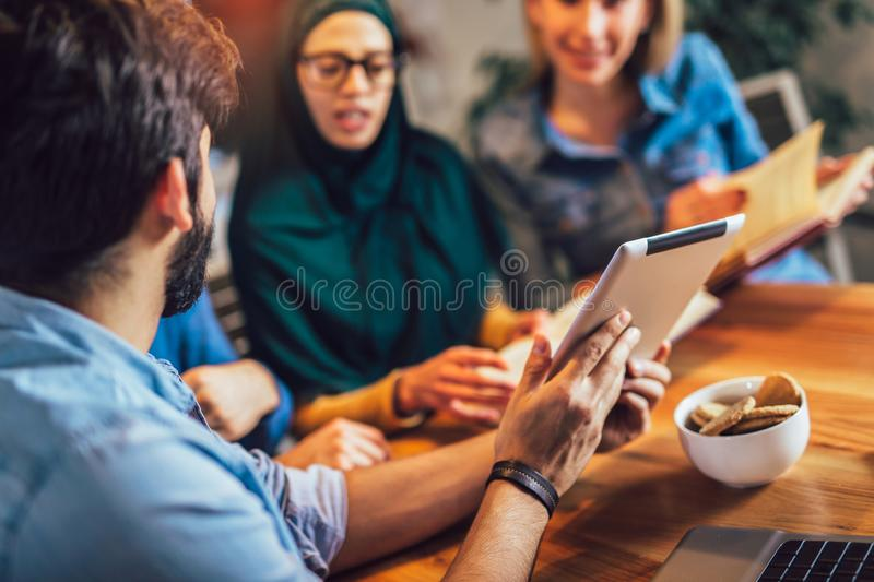 Students of diverse ethnic learning at home. Learning and preparing for university exam, selective focus royalty free stock photos