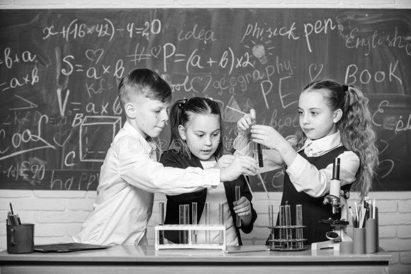Students do biology experiments with microscope. Chemistry microscope. Lab microscope. childrens day. Little kids royalty free stock image