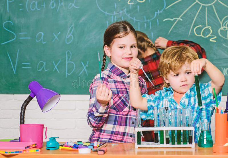 Students doing science experiments with microscope in lab. back to school. school kids scientist studying science. Children. Little kids learning chemistry in royalty free stock photo