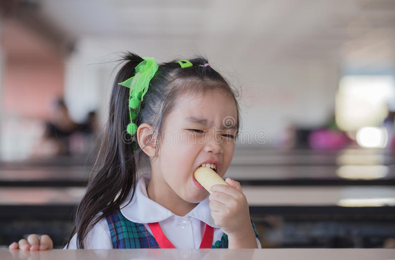 Students eat snacks stock images