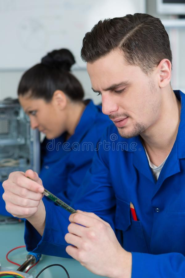Students in electronics class at university. Repair stock photo