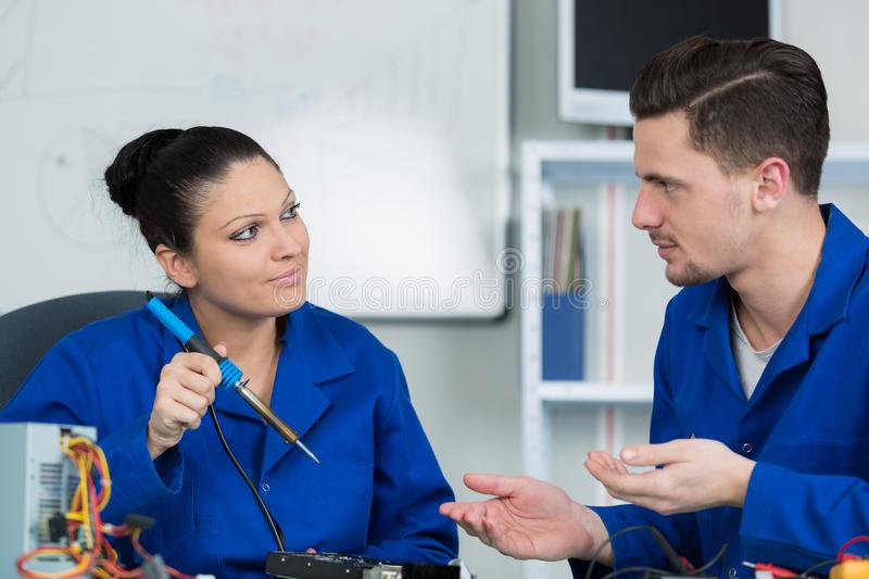 Students in electronics class at university. Repair royalty free stock photo