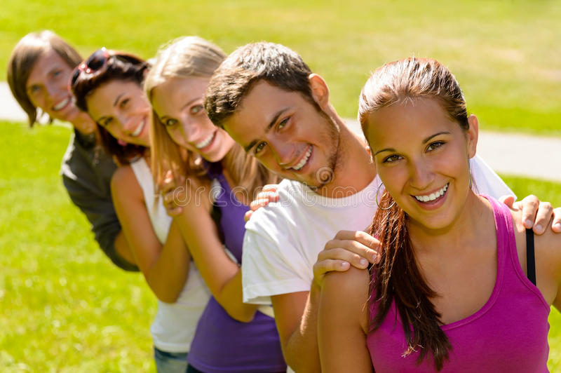 Students enjoying a break in the park stock image