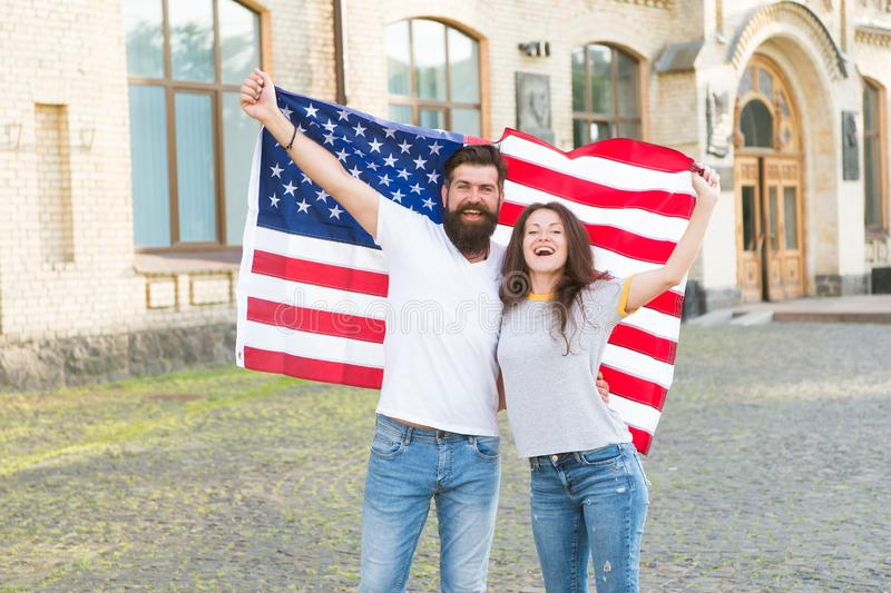 Students exchange program. National holiday. Hipster and girl celebrate 4th of July. American patriotic people. American. Couple USA flag. Patriotic spirit stock images