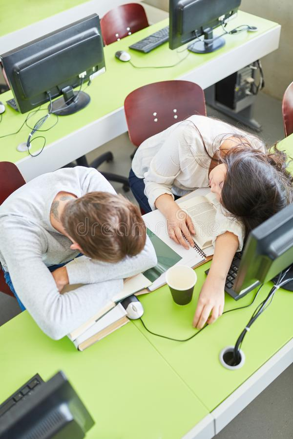 Students with exhaustion sleep in classroom. At university royalty free stock photo