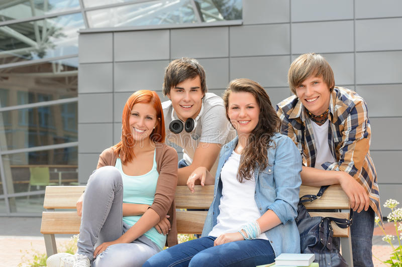 Students friends sitting bench outside campus stock images