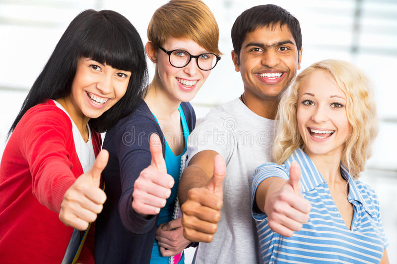 Students Giving The Thumbs-up Sign Royalty Free Stock Image