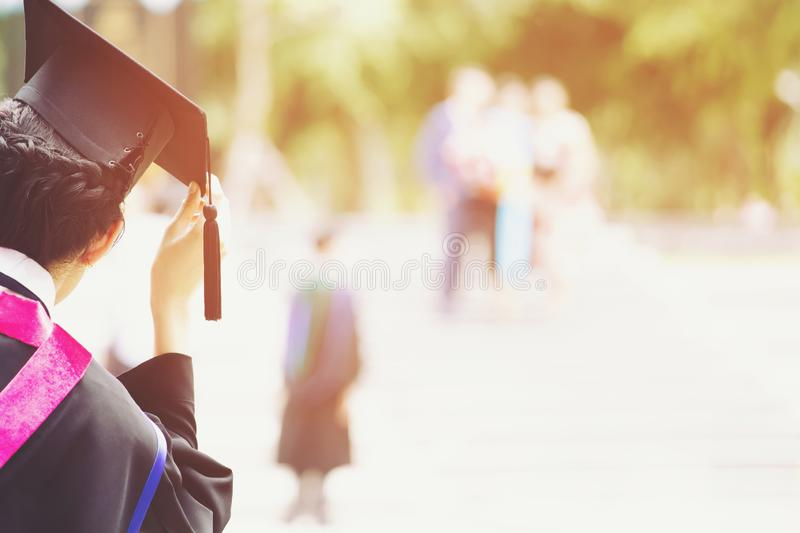 Students are graduating from university. Graduation,Student hold hats in hand during commencement success graduates of the university,Concept education stock image