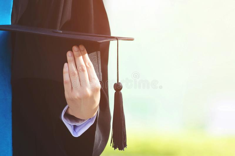Students are graduating from university. Graduation,Student hold hats in hand during commencement success graduates of the university,Concept education royalty free stock photo