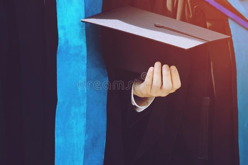 Students are graduating from university. Graduation,Student hold hats in hand during commencement success graduates of the university,Concept education stock photography