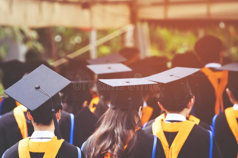 Students are graduating from university. Graduation,Student hold hats in hand during commencement success graduates of the university,Concept education stock photos