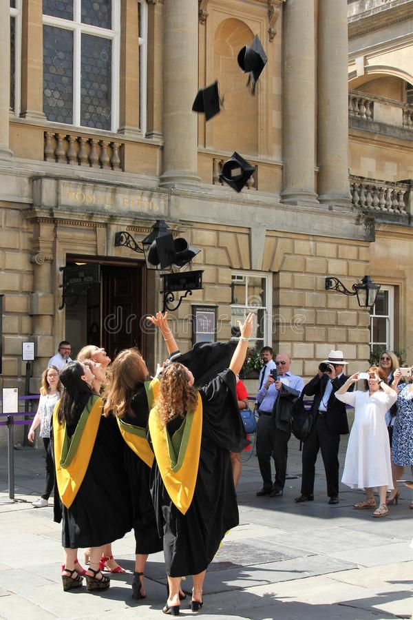 Graduates celebrating near the Roman Baths, Bath, England stock photo