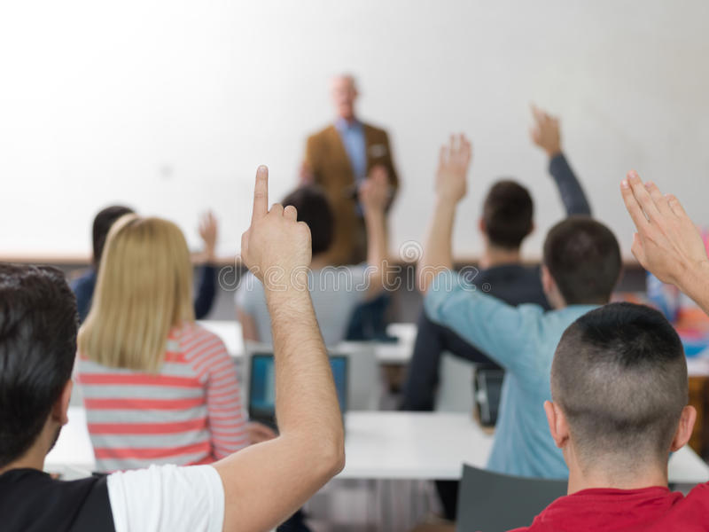 Students group raise hands up on class royalty free stock image