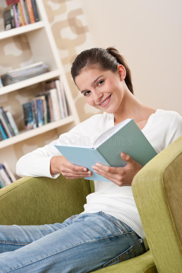 Download Students - Happy Teenager With Book On Armchair Stock Image - Image: 11942175
